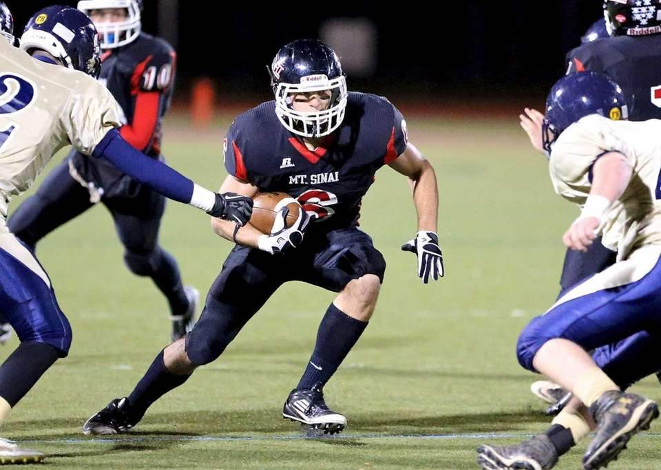 Mt. Sinai running back Mike Donadio cuts back