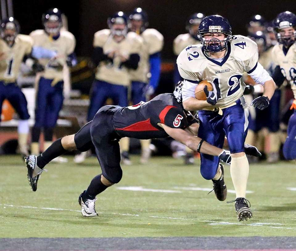 Shoreham-Wading River running back Tyler Anderson breaks the