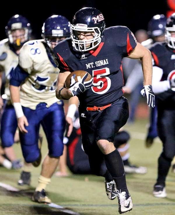 Mt. Sinai running back Mark Donadio rumbles into
