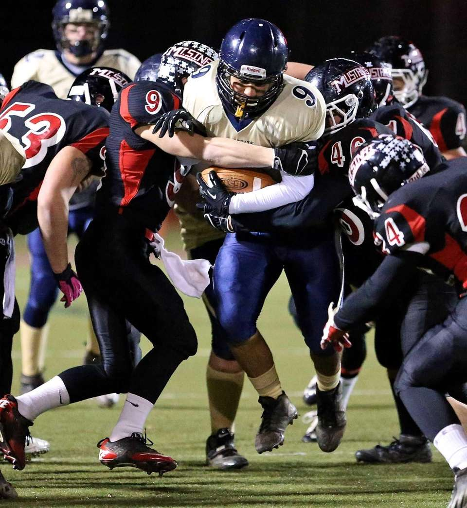 Shoreham-Wading River's Dominic Pirraglia is stopped at the