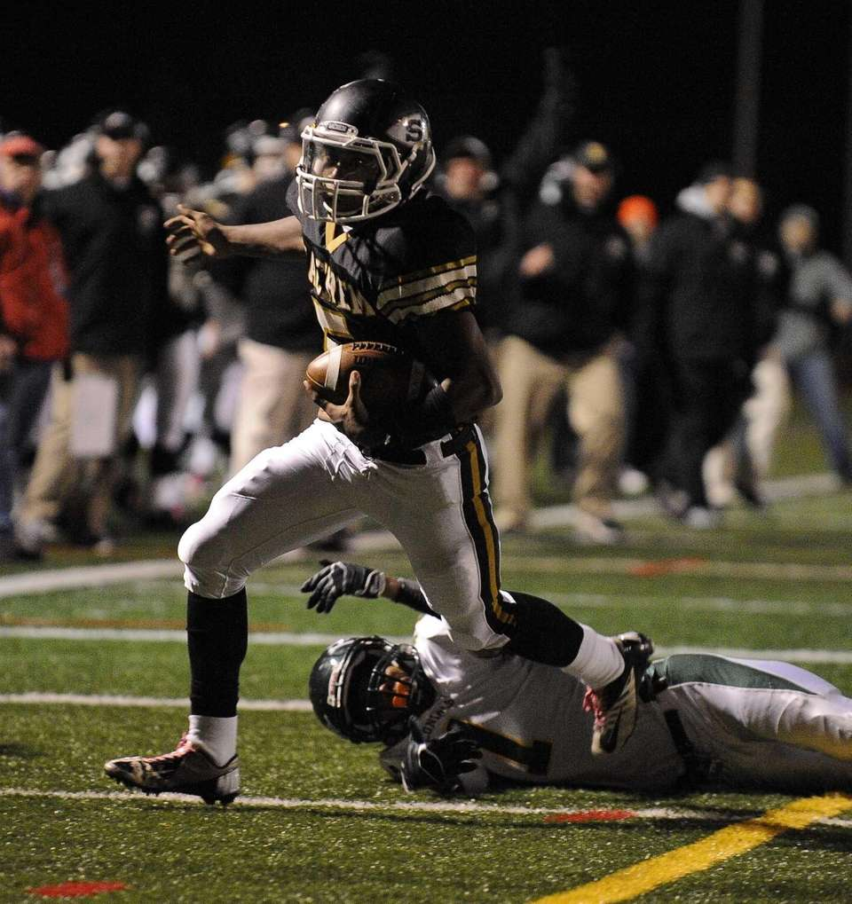 Sachem North's Malik Pierre scores a touchdown in
