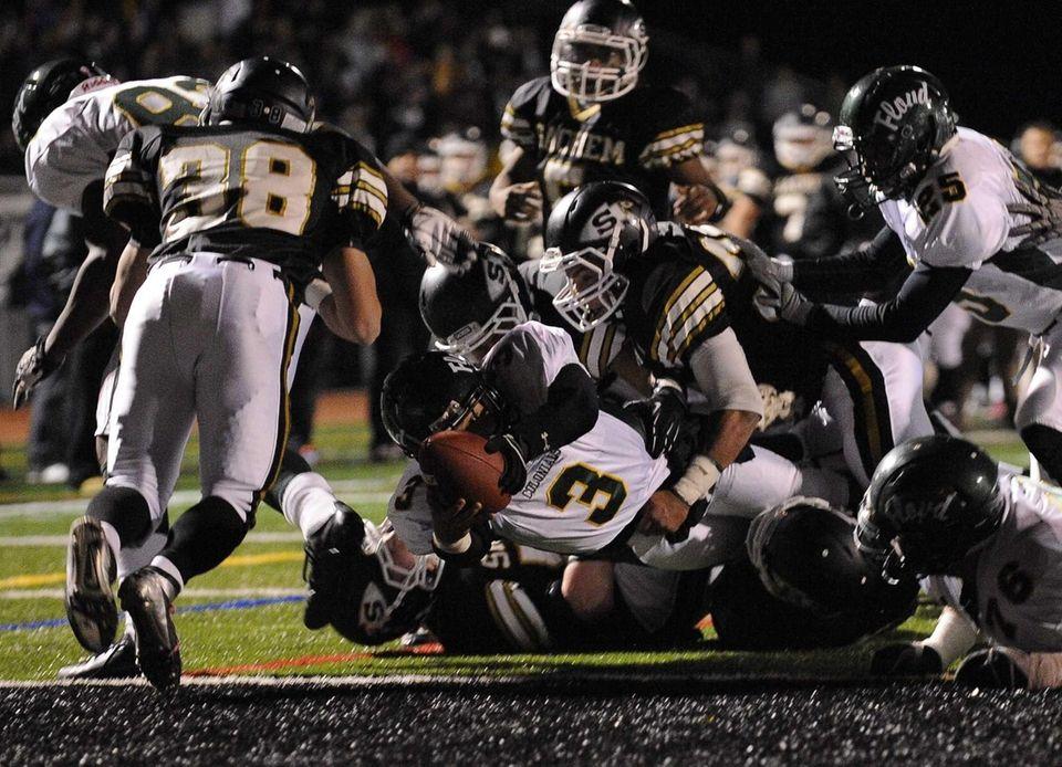 William Floyd quarterback A.J. Otranto scores a touchdown