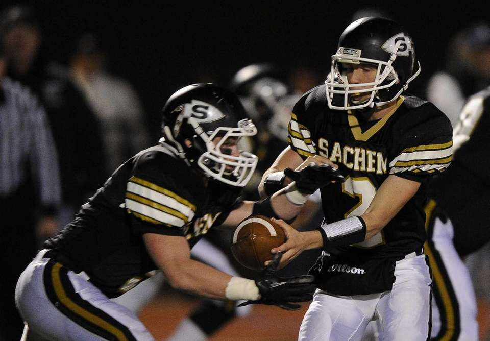 Sachem North quarterback Mike O'Donnell hands the ball