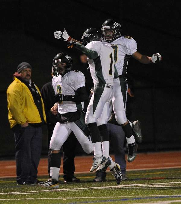 William Floyd's Chris Faison, right, celebrates his third-quarter