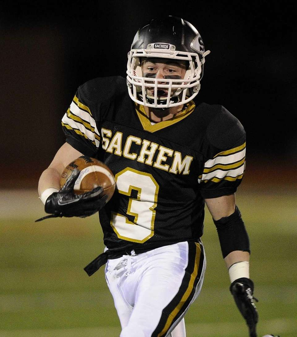 Sachem North's Kevin Lathan runs the ball against