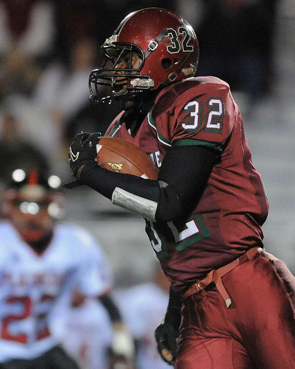 Glen Cove running back Ryan Perkins rushes for