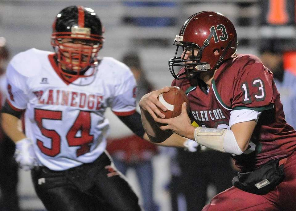 Glen Cove quarterback Will Kassar, right, runs for
