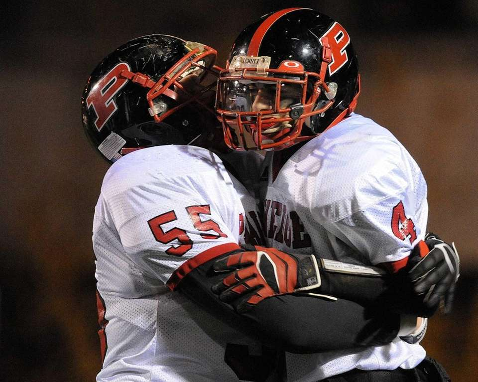 Plainedge wide receiver Nick Cupolo, right, gets congratulated