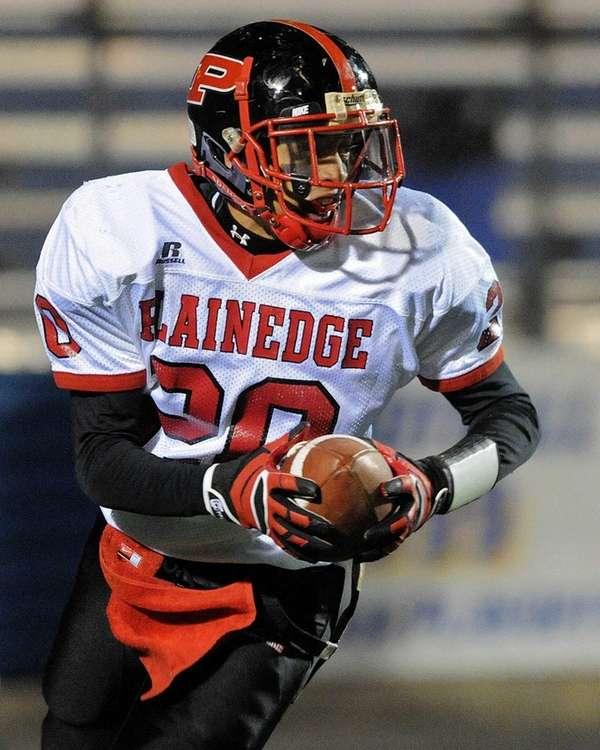 Plainedge's John Johnson heads upfield after intercepting the