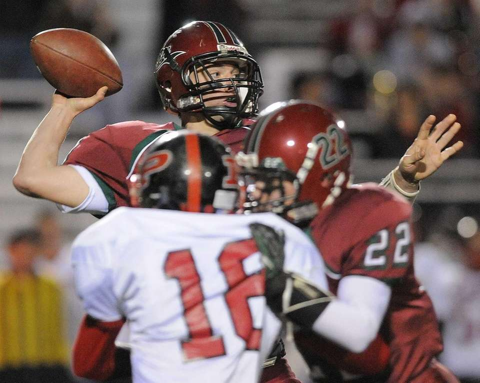 Glen Cove quarterback Will Kassar gets a block