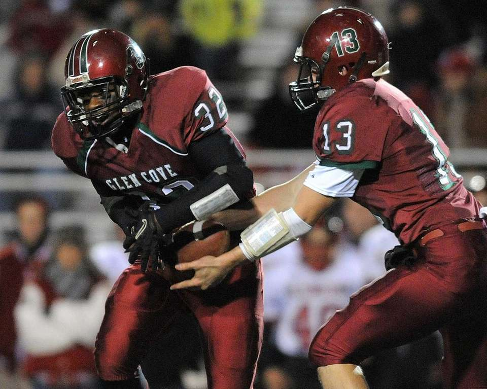 Glen Cove running back Ryan Perkins, left, sells