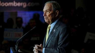 Democratic presidential candidate Mike Bloomberg holds a campaign
