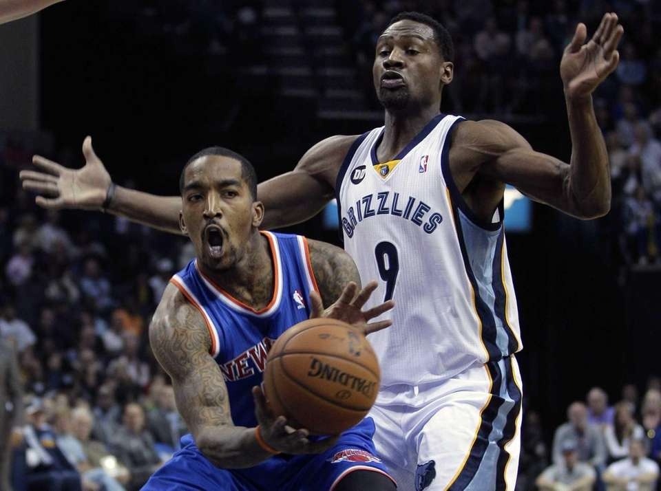 J.R. Smith, left, is guarded by the Memphis