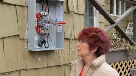 Jeanne Cappiello stands next her the new electrical