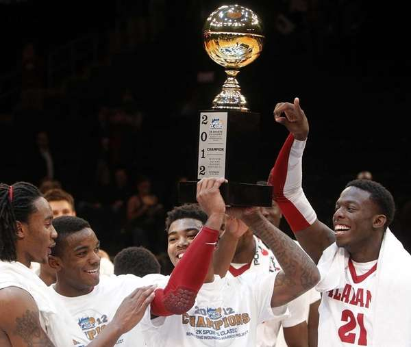 Alabama's Trevor Lacey holds up the championship trophy