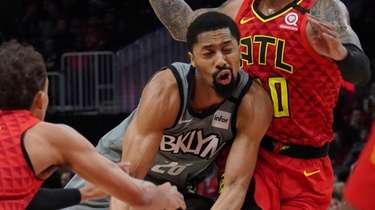 The Nets' Spencer Dinwiddie tries to drive past