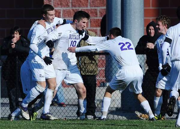 Port Jefferson's Blake Bohlen (10) celebrates his game-winning