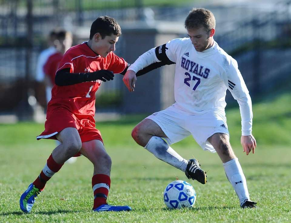 Port Jefferson's Connor Crovello, right, touches the ball