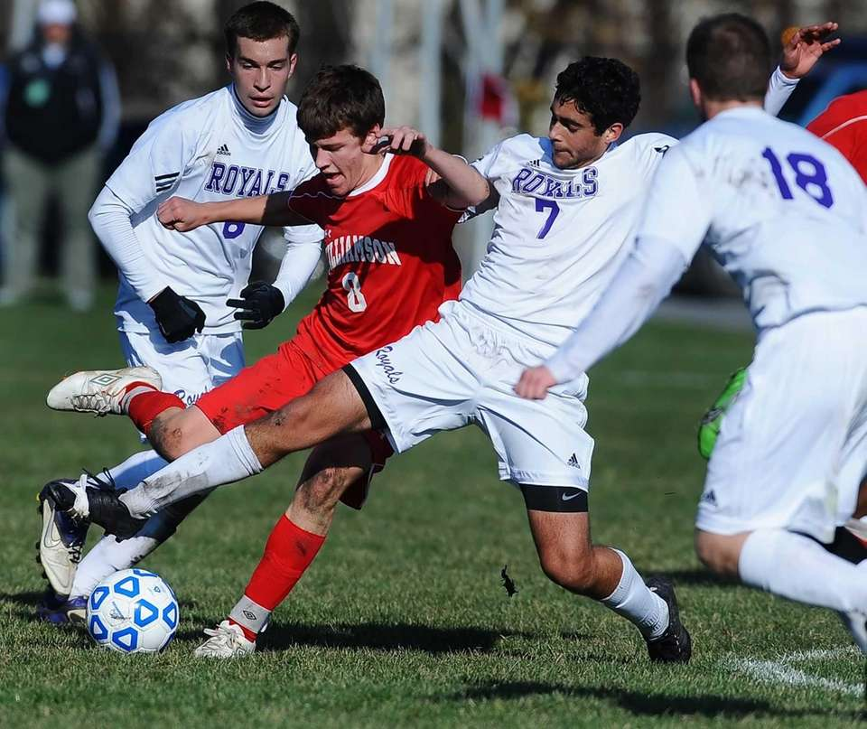 Port Jefferson's Gerard Racanelli, right, tackles the ball