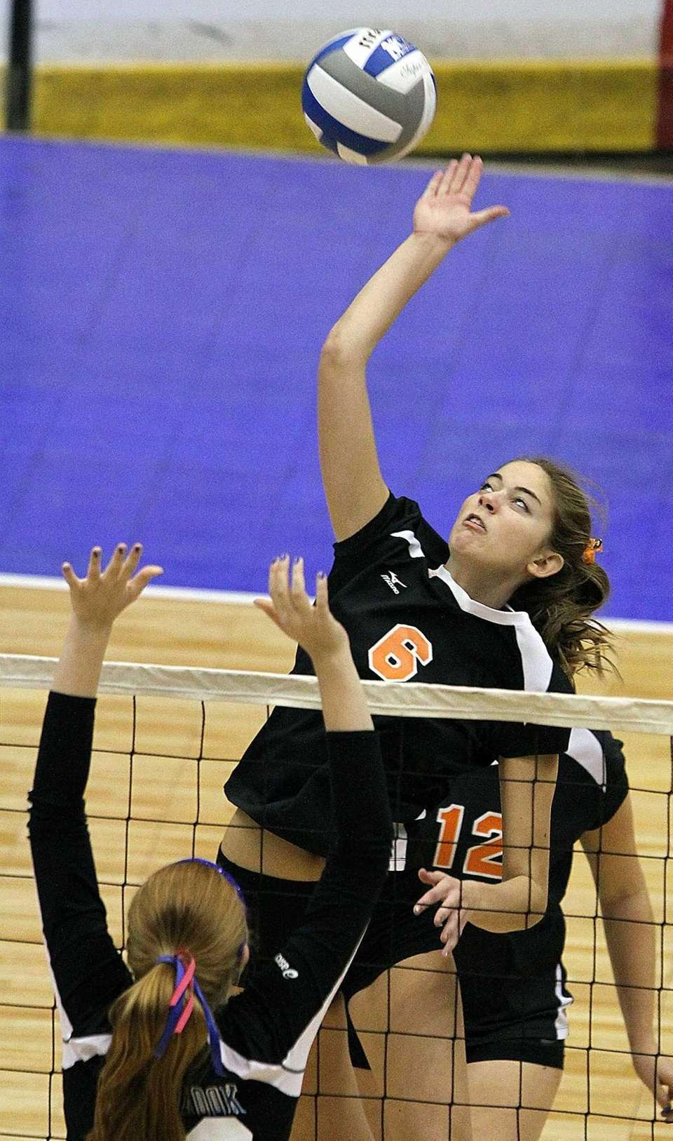 Babylon's Margot Zamet hits the ball during the