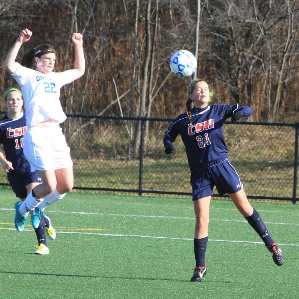 Cold Spring Harbor's #21 heads a ball at