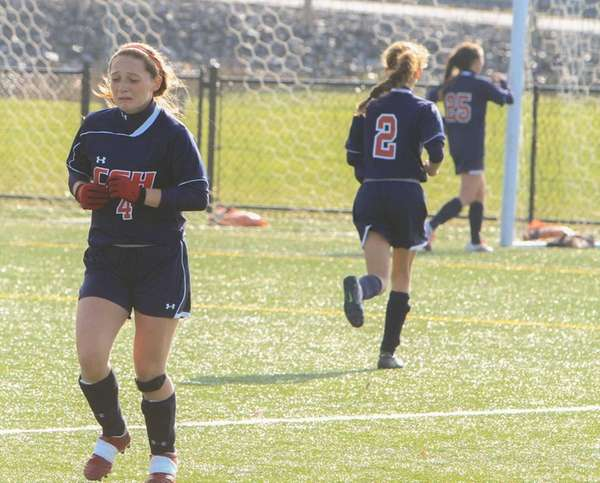 Cold Spring Harbor's Alica Roy reacts to her