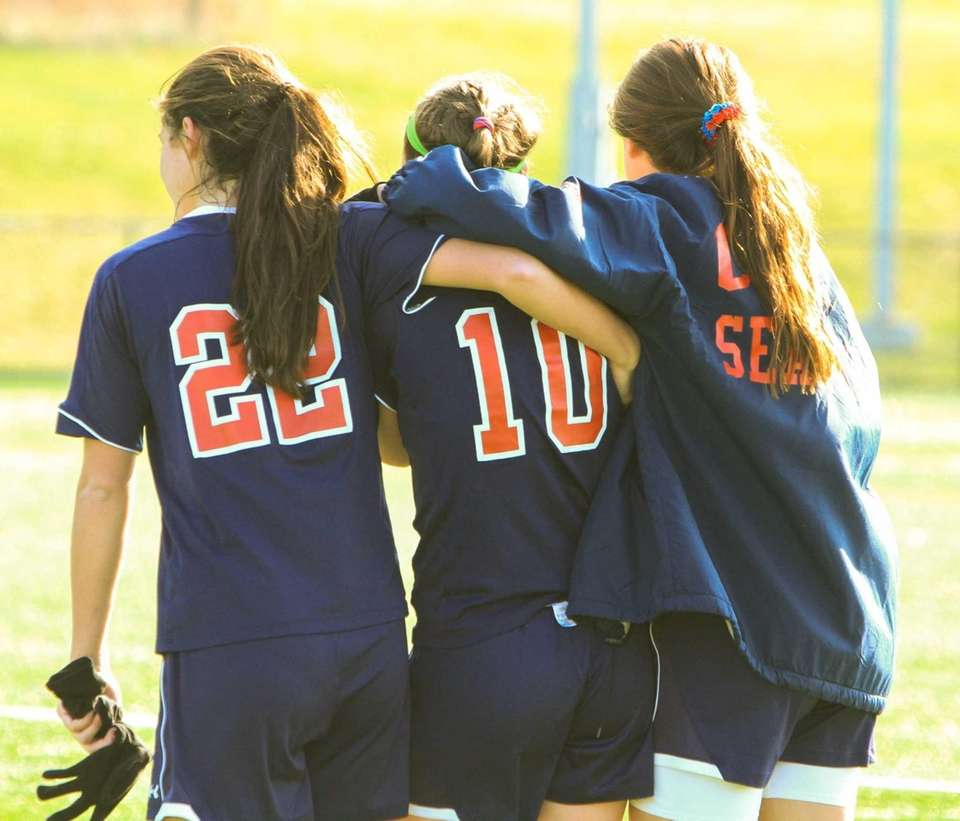 Cold Spring Harbor teammates console each other after