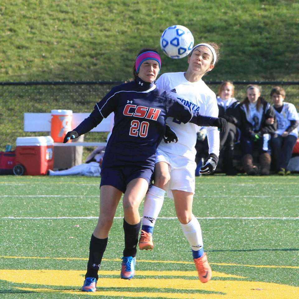 Cold Spring Harbor's Isabelle Harouche heads the ball