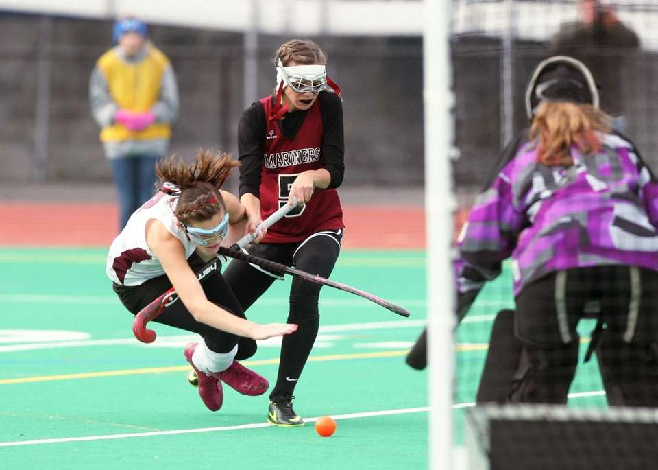 Sophomore Meggie Gallo collides with Morgan Brown on