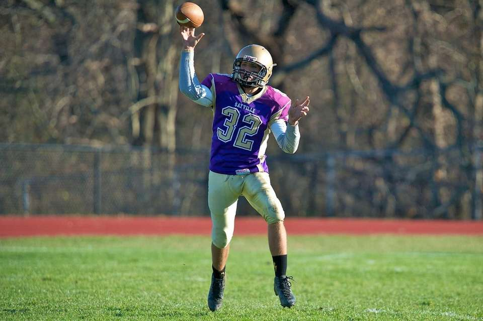 Sayville quarterback Zachary Sirico passes the ball to