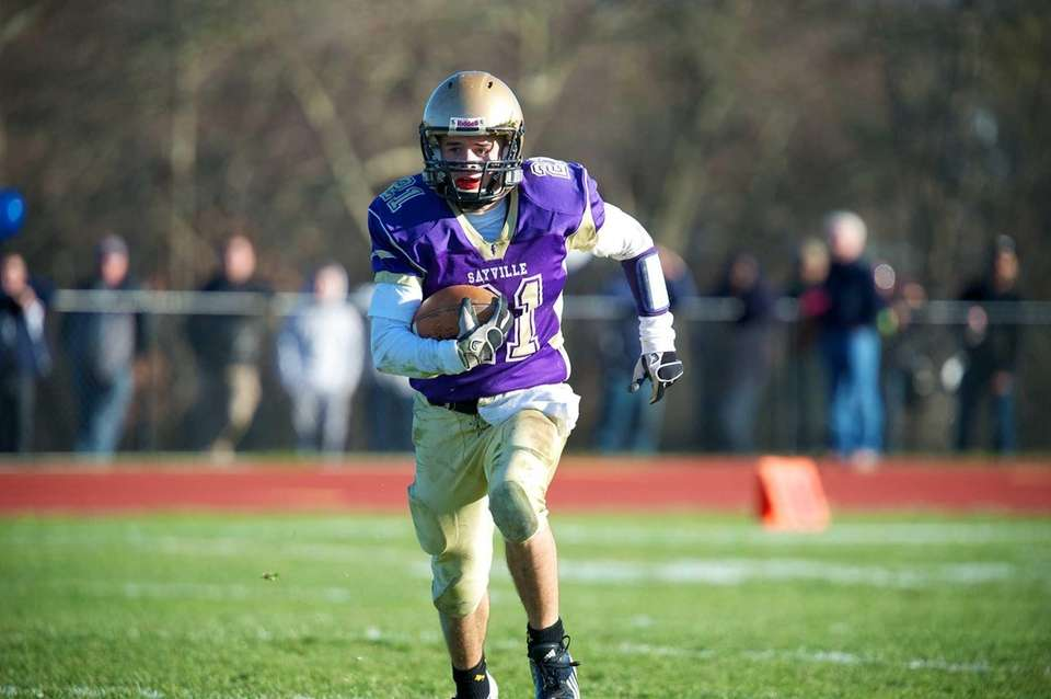 Sayville running back Matthew Selts runs toward the