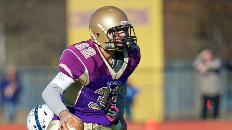 Sayville quarterback Zachary Sirico is sacked by Huntington