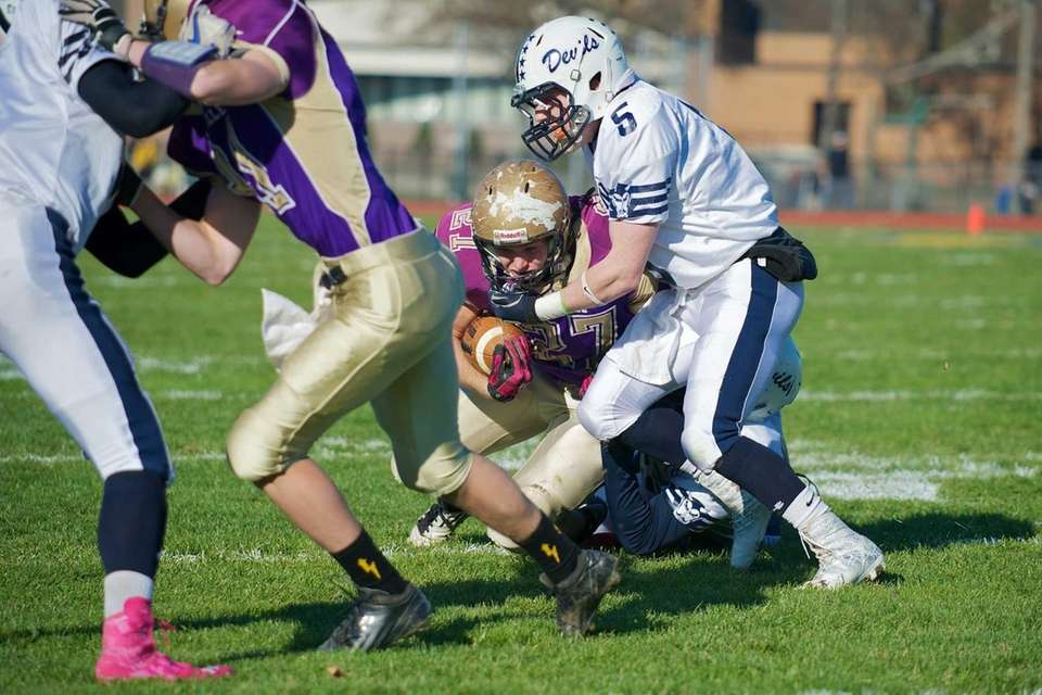 Sayville running back John Haggart dives for a