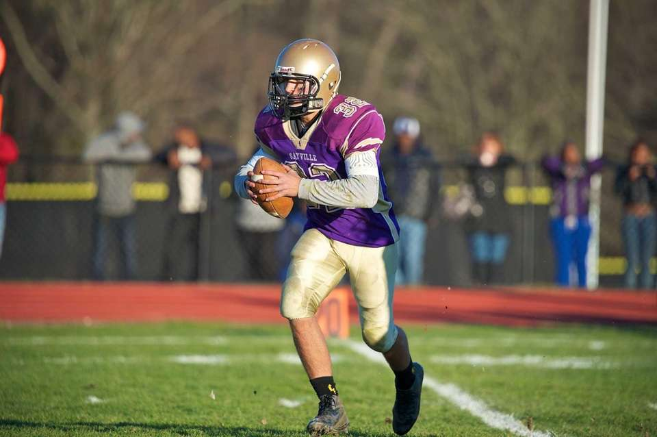 Sayville quaterback Zachary Sirico runs a sneak play