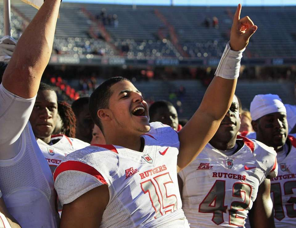Rutgers quarterback Gary Nova acknowledges the fans after