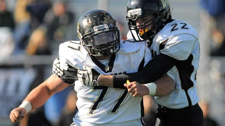 Wantagh's Nick English, left, gets congratulated by teammate
