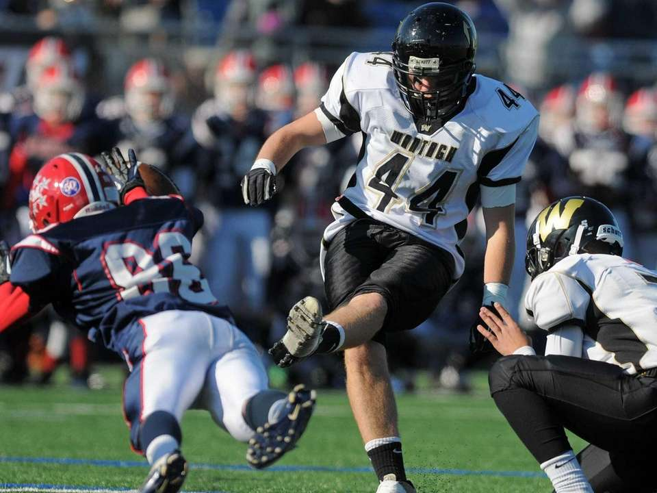 Wantagh's Andrew Martorella kicks the game-winning point after