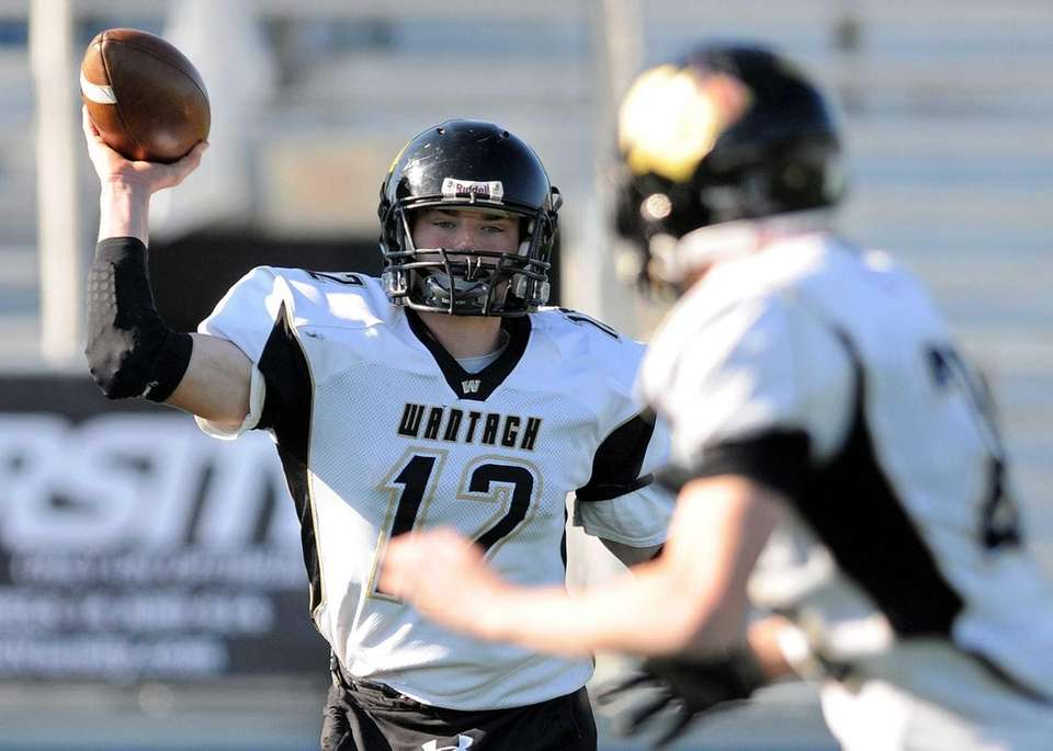 Wantagh High School quarterback Roddy Roche, left, throws