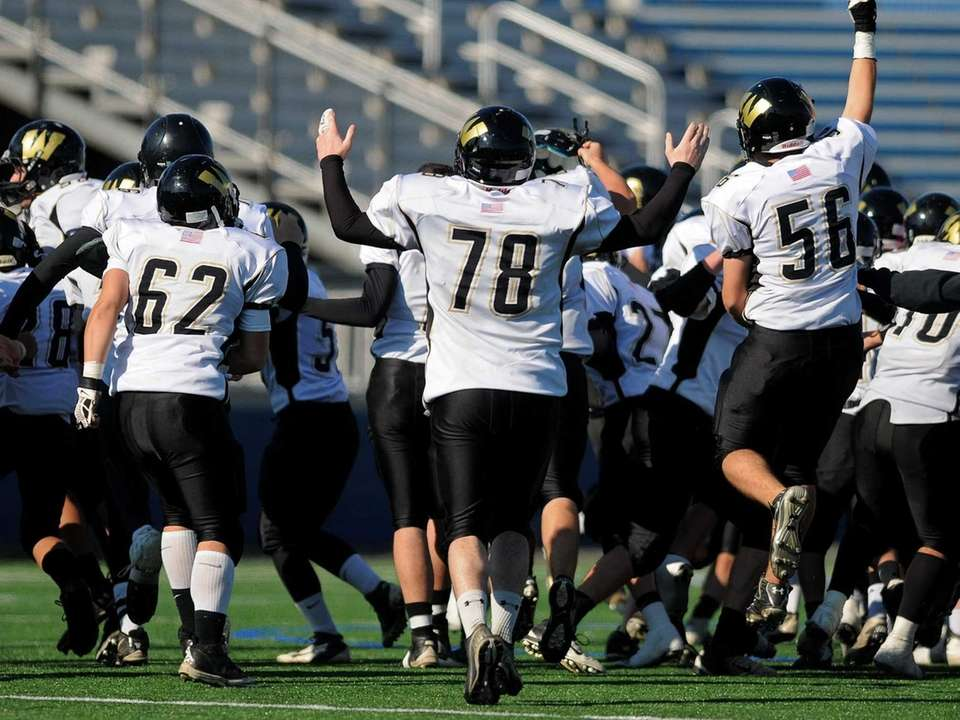 Wantagh High School teammates mob the field to