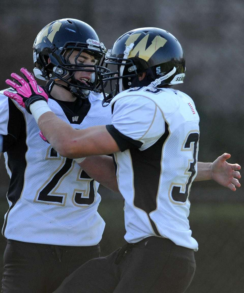 Wantagh High School running back Brandon Watson, left,