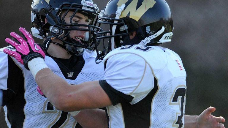 Wantagh High School running back Brandon Watson, left,