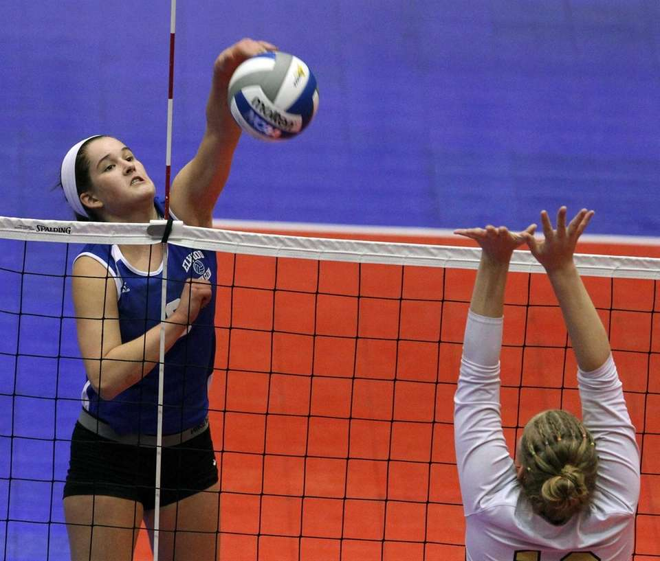 John Glenn's Samantha Czeczotka goes for the spike