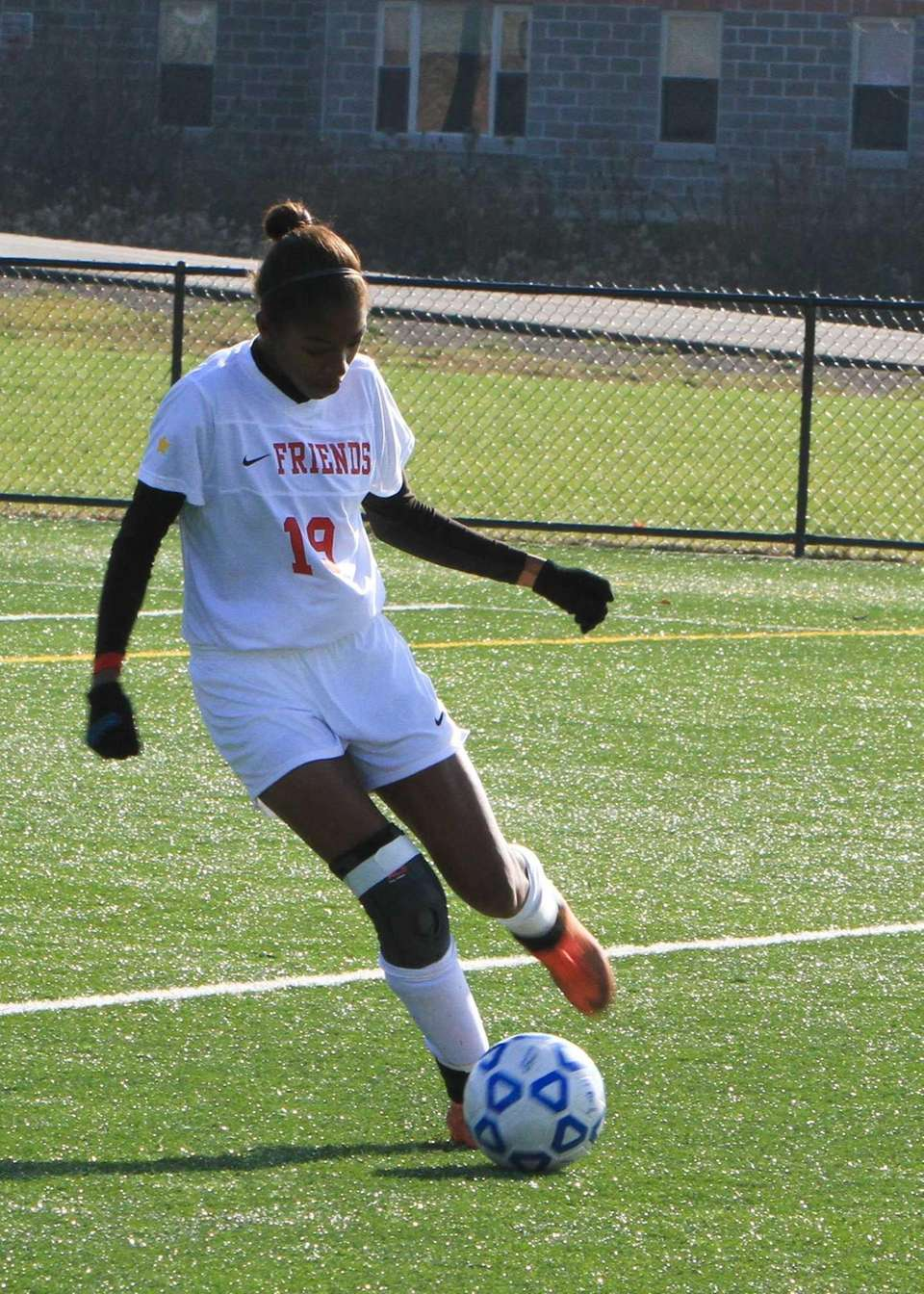 Friends Academy's Alexis Toles kicks the ball. (Nov.