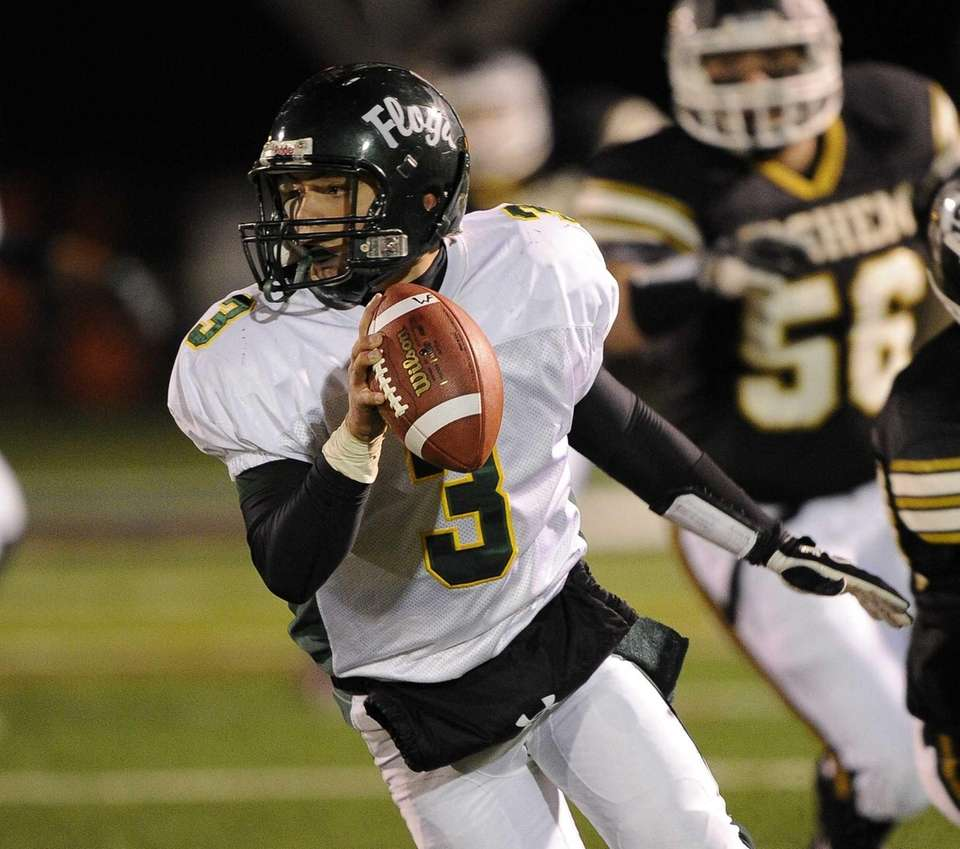 Floyd quarterback A.J. Otranto scrambles to avoid being