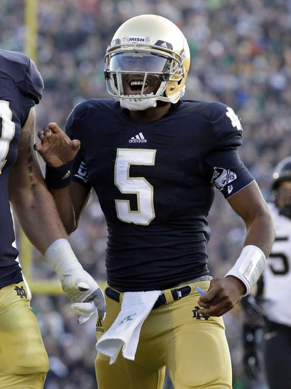 Notre Dame quarterback Everett Golson reacts after throwing