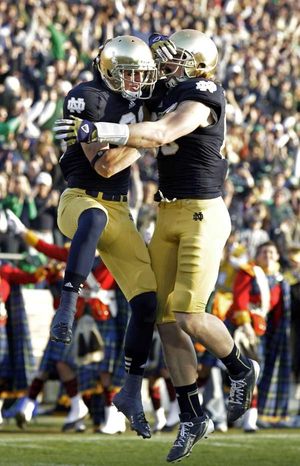 Notre Dame wide receiver John Goodman, left, celebrates