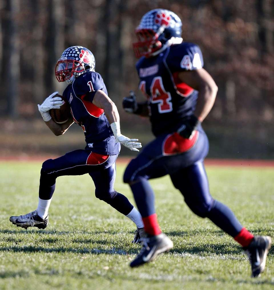 MIller Place running back Aidin Greenfield breaks into