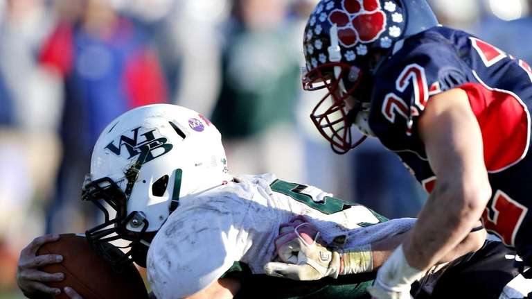 Westhampton quarterback Jack Murphy dives into the end