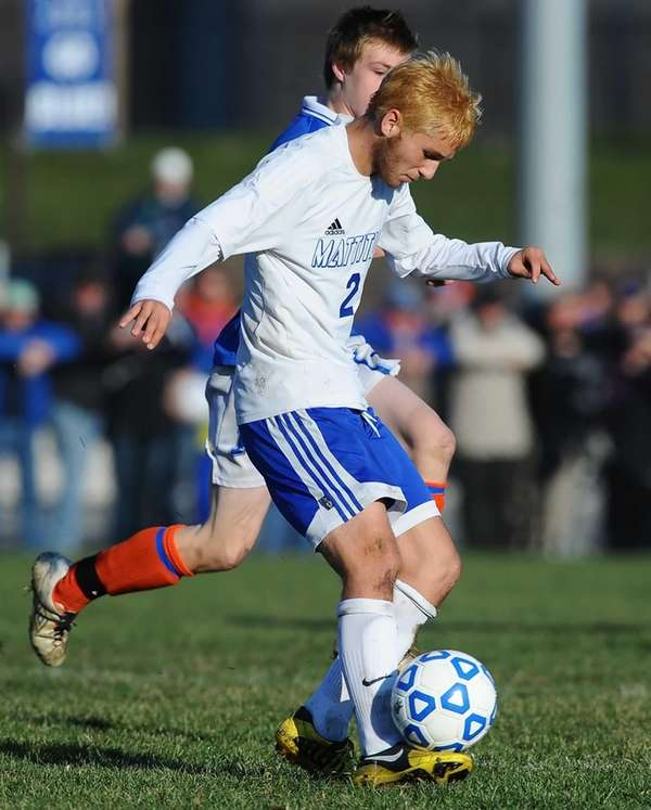 Mattituck's Evan Neighly chips the ball upfield. (Nov.