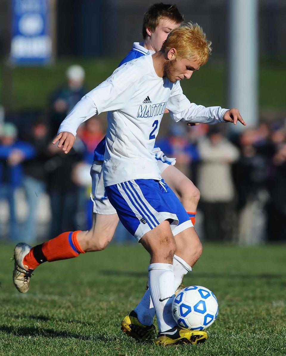 Mattituck's Evan Neighly chips the ball upfield. (Nov.